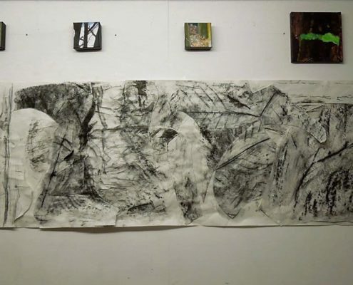 Charcoal artwork on wall