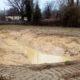 excavated depression with rainwater
